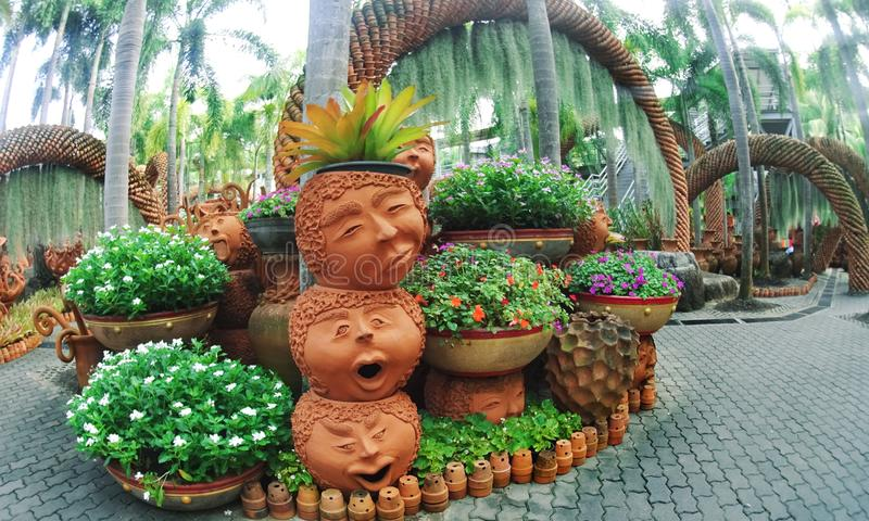 Nong Nooch Park Pattaya with an unusual landscape design of ceramic pots in the form of funny faces and lots of greenery royalty free stock image
