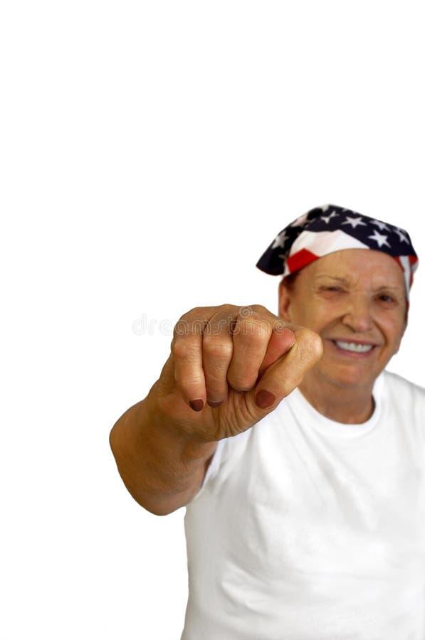 Nonna sorridente con il fico fotografia stock