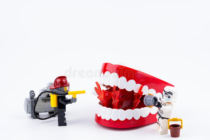 Nonthabure, Thailand - May, 17, 2017 : Lego Fireman and Lego stormtrooper helping extinguish the fire in the red plastic stock images
