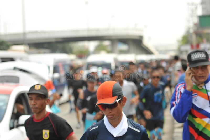 Nonthaburi - DEC 6 2017 : On the way of Thai celebrity rocker `Toon Bodyslam` takes on 55-day running marathon to raise money for stock images