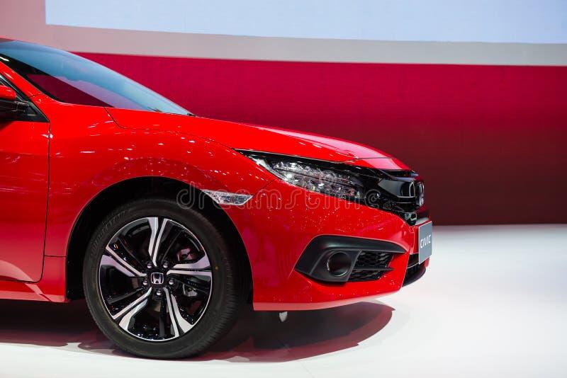 NONTHABURI, TAILANDIA - DICIEMBRE 9,2017: Vista de todo el nuevo coche del color rojo de Honda Civic en cabinas en la Motor-expo  foto de archivo libre de regalías