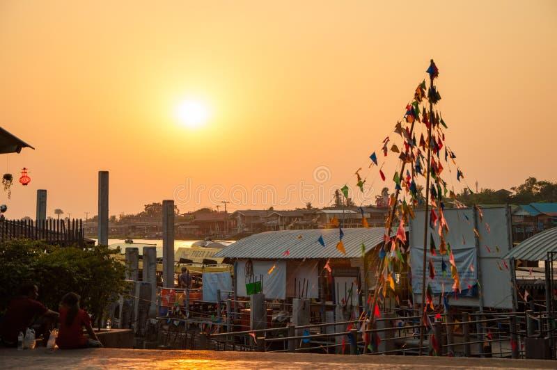 Nonthaburi, Thailand-April 10, 2016 : evening view at riverfront. Under Rama4 bridge with party flags pole, Pakkret, Nonthaburi, Thailand royalty free stock photo