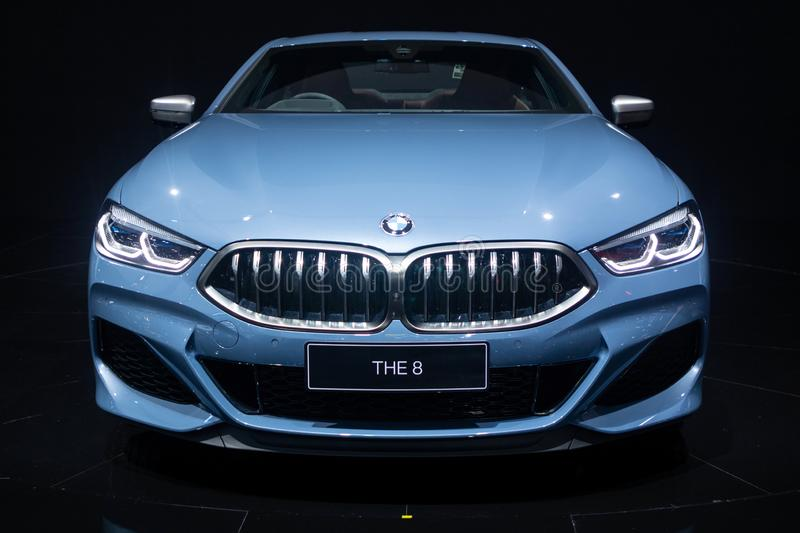 Nonthaburi , Thailand - Dec 6, 2018: BMW the 8 Series Coupe blue color in motor expo . close up car bonnet and headlights , black. BMW the 8 Series Coupe blue royalty free stock photos