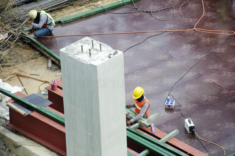 Thai people worker weld steel in construction site making reinforcement metal framework for concrete pouring in Bangkok, Thailand stock photography