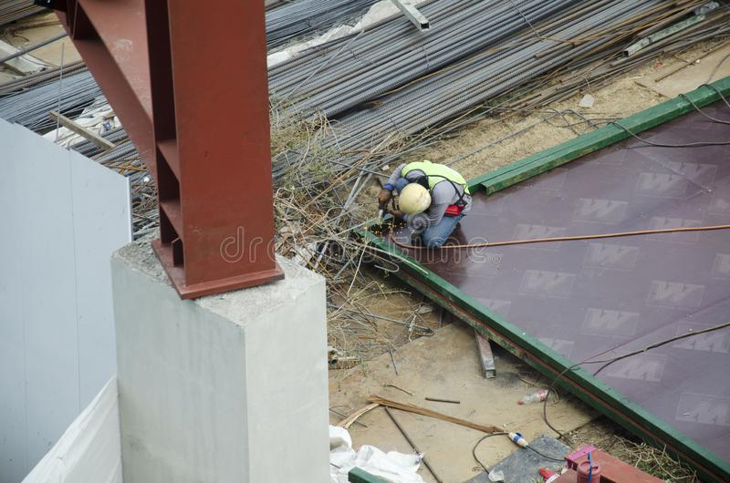 Thai people worker weld steel in construction site making reinforcement metal framework for concrete pouring in Bangkok, Thailand royalty free stock photo