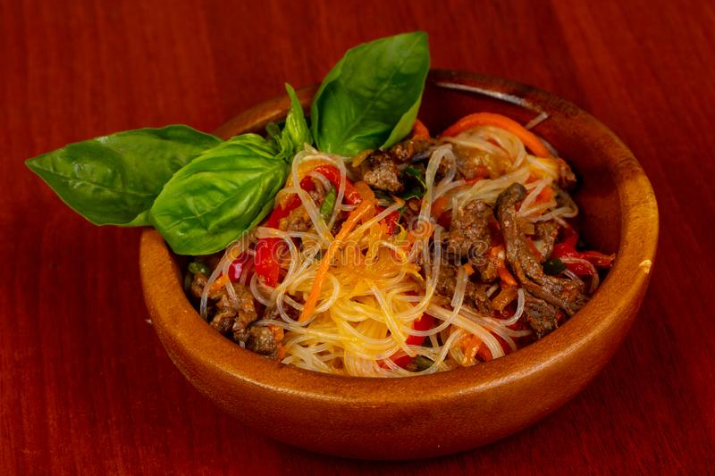 Noodle with beef. Served basil stock photo
