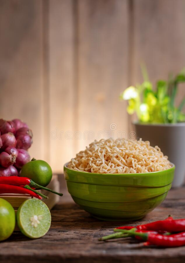 Noodle in a bowl with lime and chili and onion and vegetable royalty free stock images