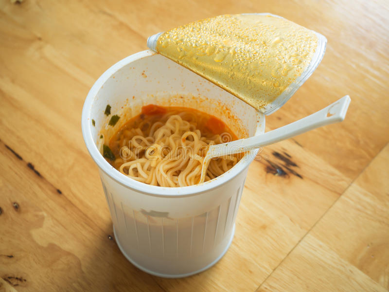 Noodle cup with a Plastic Fork stock images
