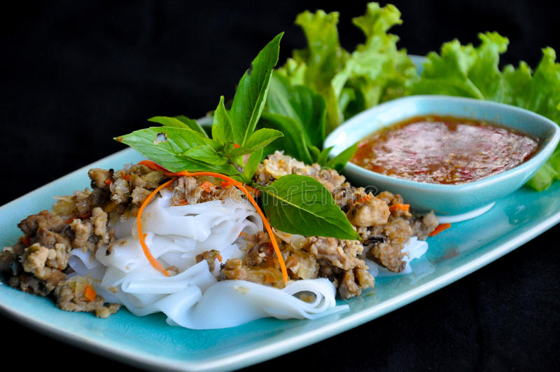 Noodle with minced pork and sour and spicy sauce stock images