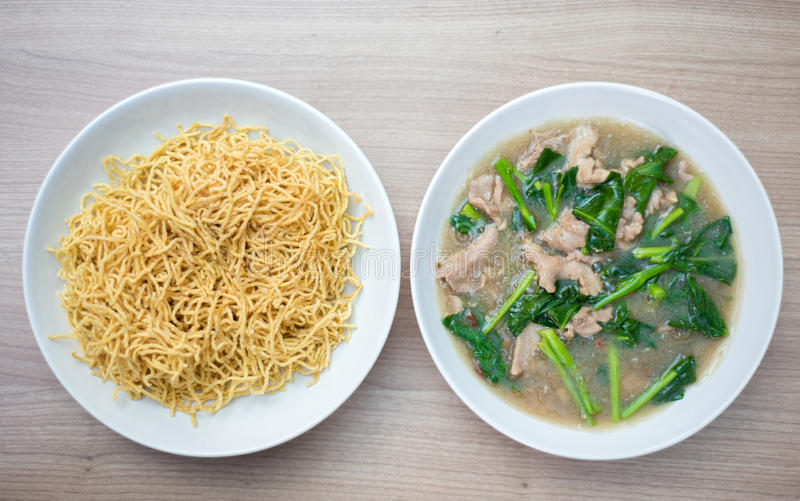 Noodle with pork soaked in gravy royalty free stock photography