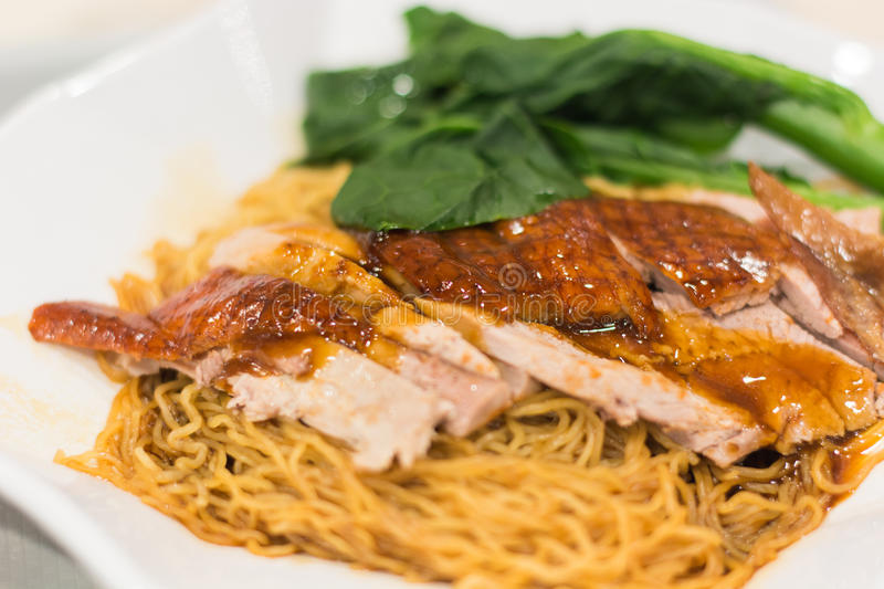 Noodle roast duck. On the table stock photos