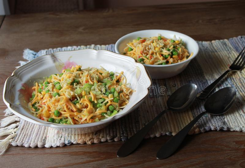 Noodle salad bowls on the table ready to serve. Noodle sald bowls on the rustic wooden table ready to serve stock photos