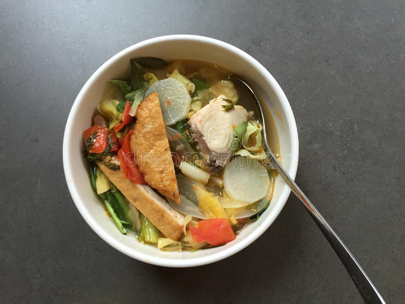 Noodle soup with fish and vegetables (Vietnamese: Bun ca). Vietnamese cuisine royalty free stock images