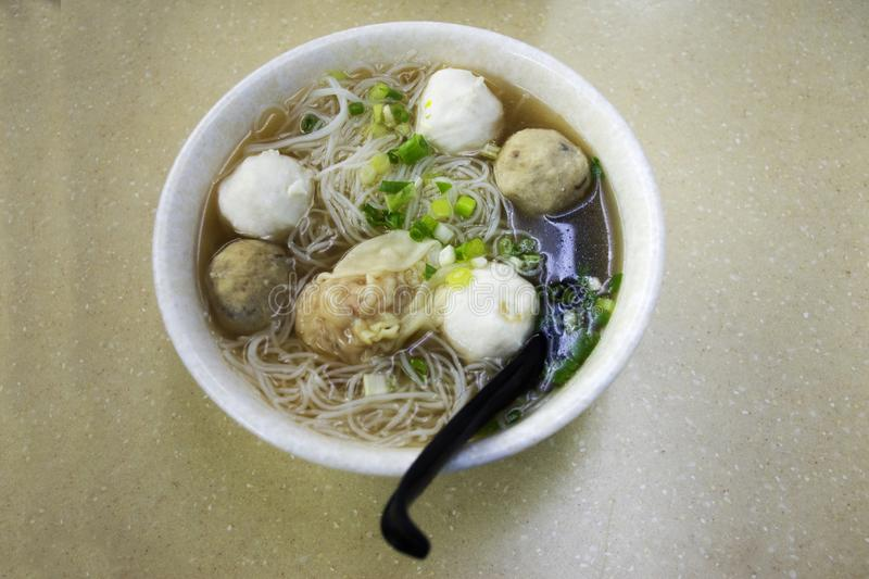 Noodle soup with pork meatball and seafood meatball Hong Kong style royalty free stock photos