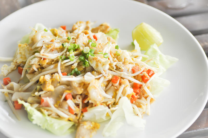 Noodle,Stir-fried noodle with chicken. Stir-fried rice noodle with chicken,Fried Noodles with Chicken,Stir-fried fresh rice-flour noodles with chicken and egg royalty free stock photos
