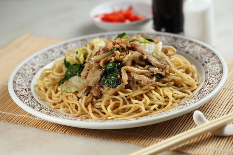 Noodles. Chinese fried noodles with chopstick and soya source stock photo