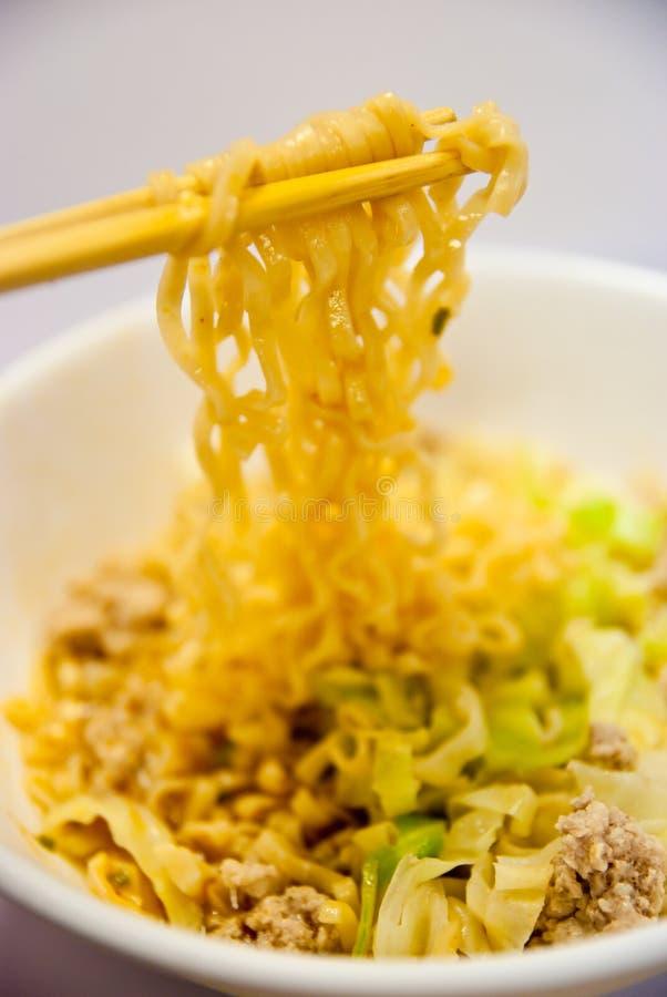 Noodles. Chopsticks,bowl and noodles on white background stock images