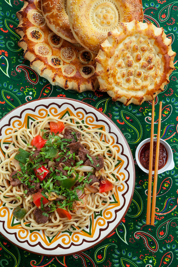 Noodles with beef and vegetables. Central Asian cuisine. Lagman royalty free stock photography