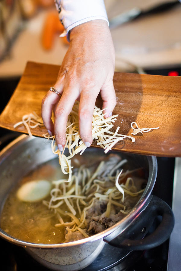 Noodles cooking stock photography