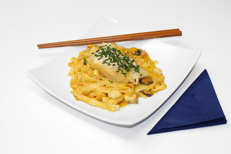 Noodles and fish. royalty free stock image