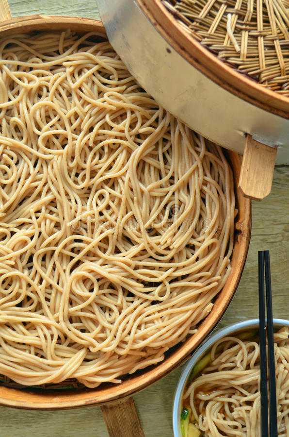 Noodles. Flour noodles bowl covers small wheat food steaming food steamers steamer chopsticks dishes cooked delicious gourmet cuisine photography stock photography
