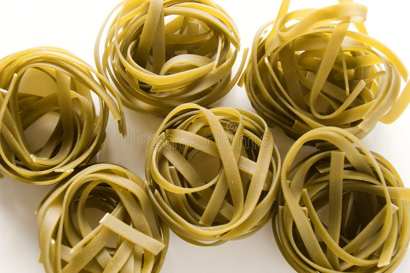 Noodles. Isolated spinach green noodles on white background royalty free stock photo