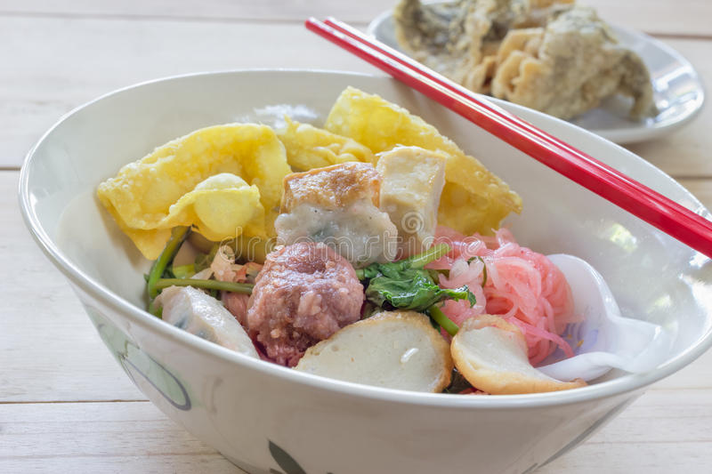 Noodles with meat ball and red sauce or yong tau foo,Thai Noodle.  stock image