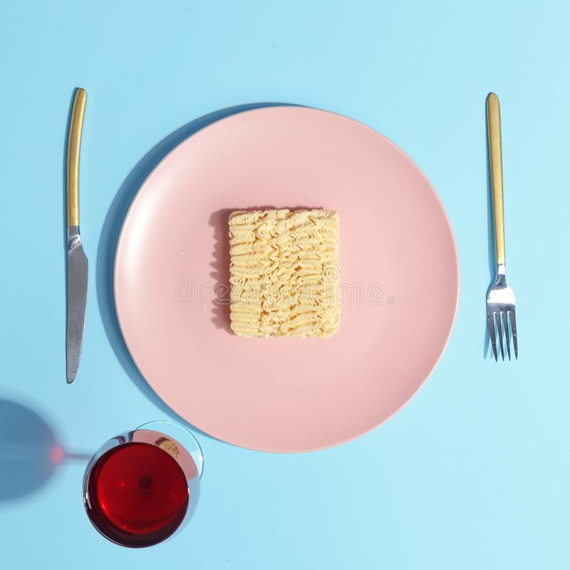 Noodles on a pink plate. Minimalistic concept. Top view. Round background white above table clean dinner food empty dish space object isolated lunch cuisine royalty free stock images
