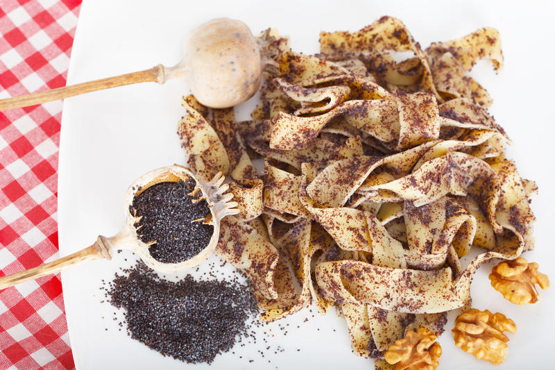 Noodles with poppy seeds and walnuts stock image