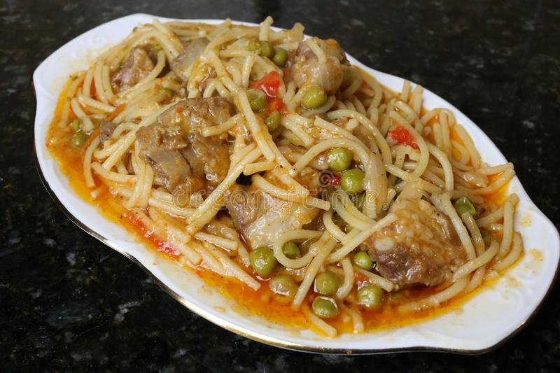 Noodles with pork ribs andalusian and spanish cuisine. Noodles with pork ribs a recipe for Andalusian and Spanish cuisine. Photo of pasta dish and Iberian pork royalty free stock images