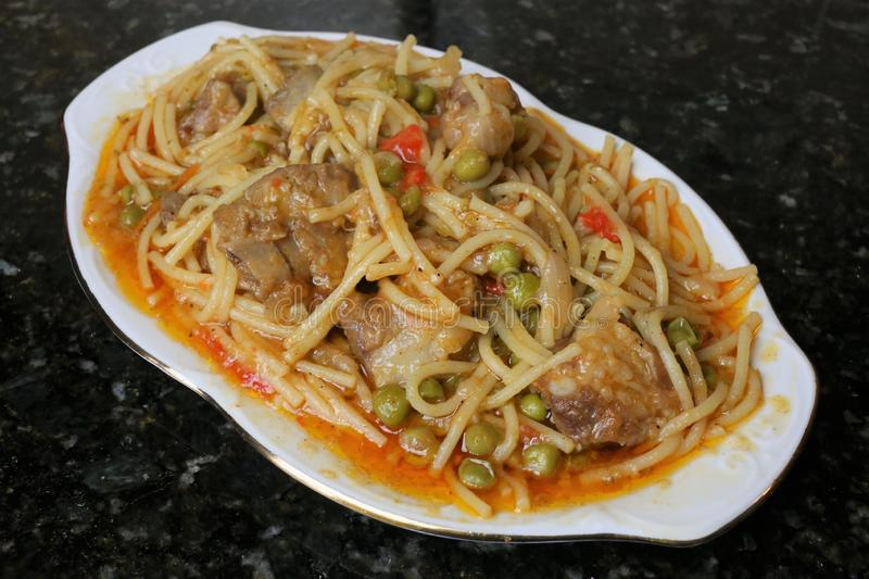 Noodles with pork ribs andalusian and spanish cuisine. Noodles with pork ribs a recipe for Andalusian and Spanish cuisine. Photo of pasta dish and Iberian pork royalty free stock photo