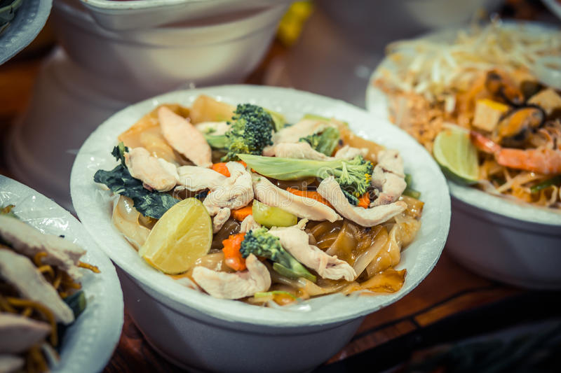 Noodles with seafood and vegetables. Night food market, Thailand. royalty free stock photo