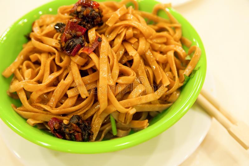 Noodles served with soy sauce stock image