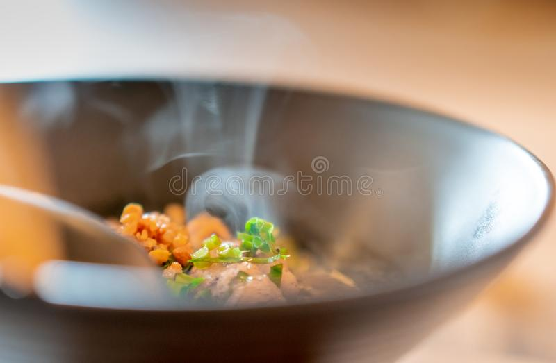 Noodles soup with boiled pork. Fresh and hot noodle soup in bowl on the table in restaurant. Street food in Thailand. Thai style. Lunch. Asian food stock photography