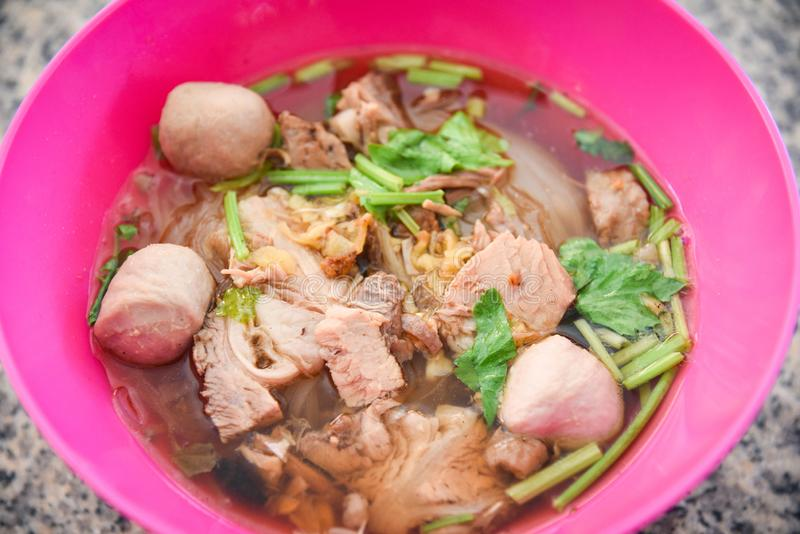 Noodles soup bowl with pork meat ball and vegetables / traditional thai and chinese style food of asian royalty free stock photo