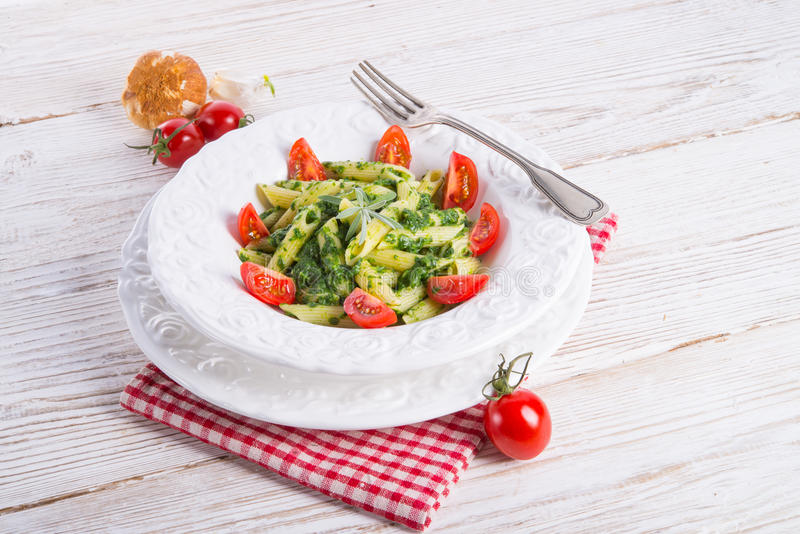 Noodles with spinach royalty free stock image