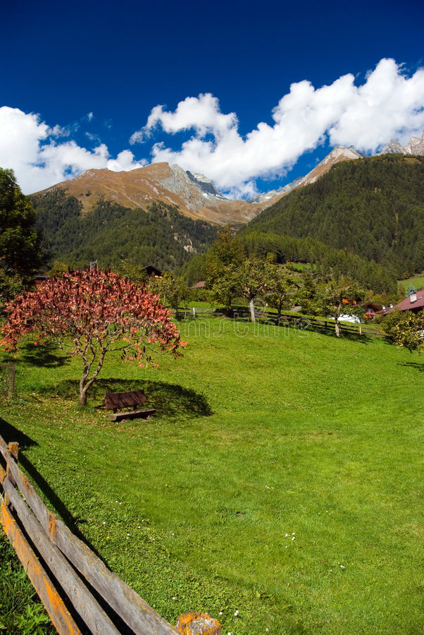Nook in garden. In background alpine peaks royalty free stock photography