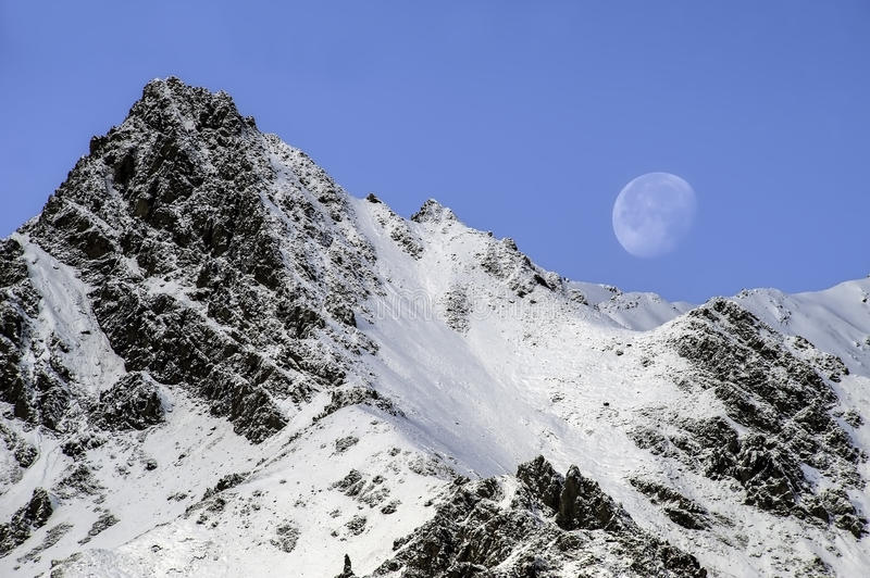 Noon Moon. I took this Mountain and moon picture at noon in Denali park royalty free stock images