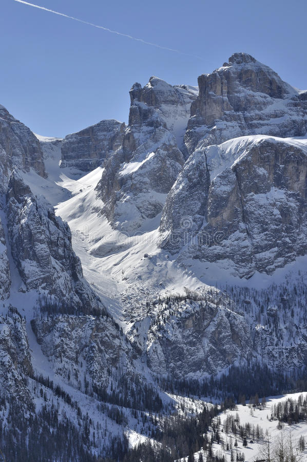 Noon valley, piz boe', dolomites. View of famous valley in dolomite with steep cliffs and snowy slopes, shot in bright winter light from the north side of the royalty free stock image