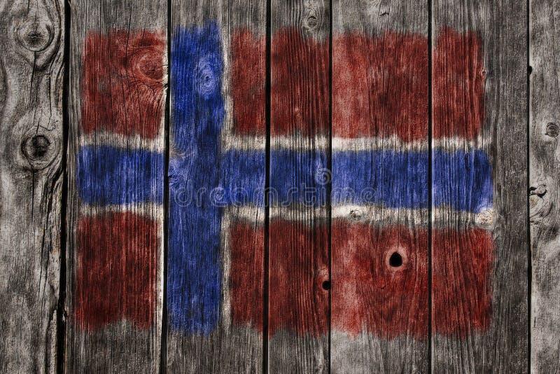 Noorse vlag op houten wond stock foto's