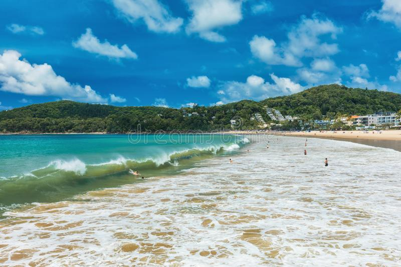 NOOSA, AUSTRALIA, FEB 17 2018: People enjoying summer at Noosa m. Ain beach - a famous tourist destination in Queensland, Australia stock photo
