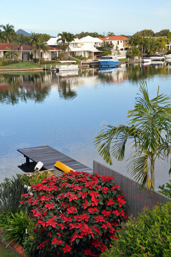 Noosa Waters Houses, Canal, Boats, Jetty & Flowers, Queensland A royalty free stock images