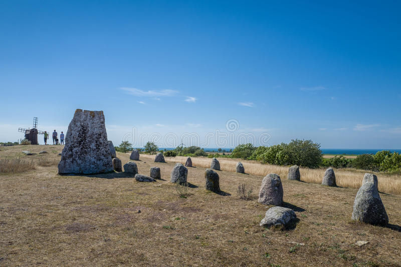 Nordic bronze age grave field in Sweden. Gettlinge, Sweden - August 15, 2015: Tourists explore Gettlinge grave field with its famous stone ship. The oldest royalty free stock images