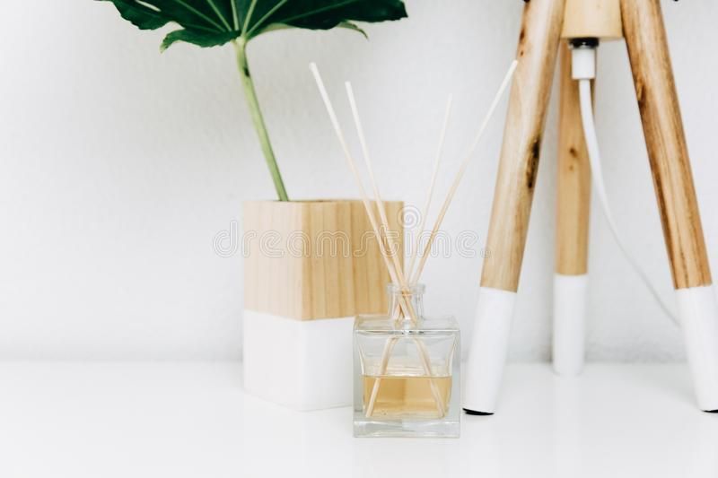 Nordic modern living room with table lamp, home fragrance and tropical leaf. Minimal design royalty free stock images