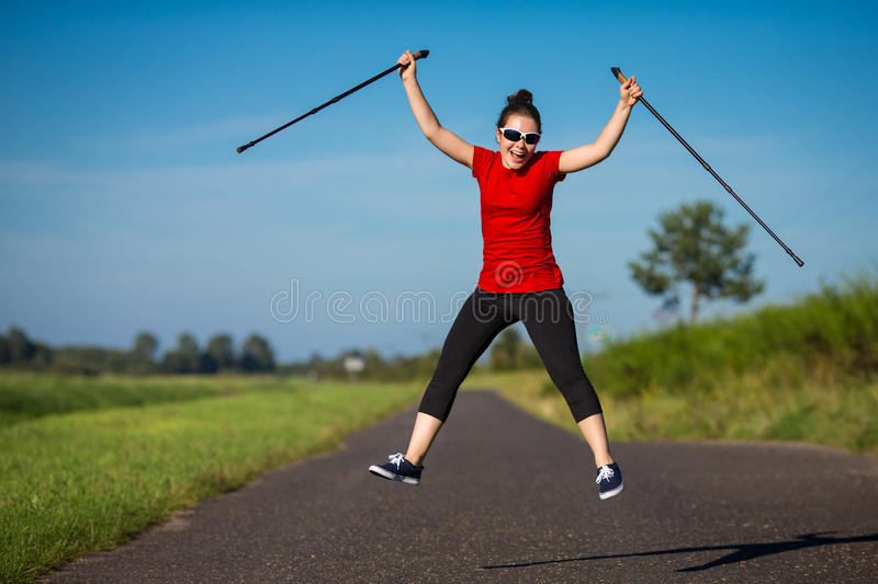 Nordic walker. Nordic walking - active people outdoor royalty free stock photography