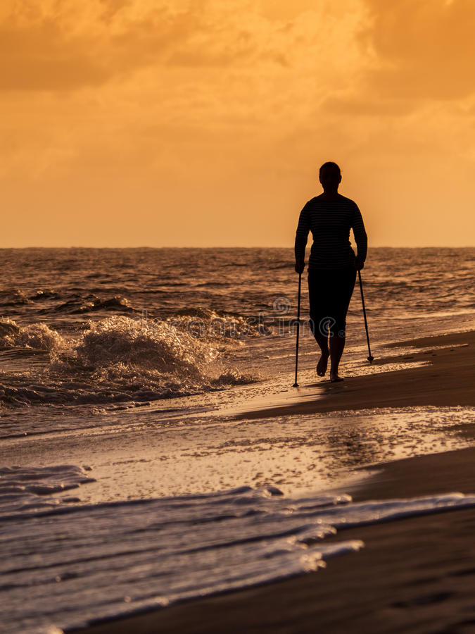 Nordic walking on the beach royalty free stock photo