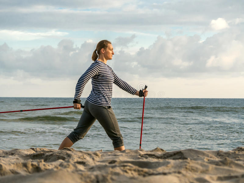 Nordic walking on the beach royalty free stock image