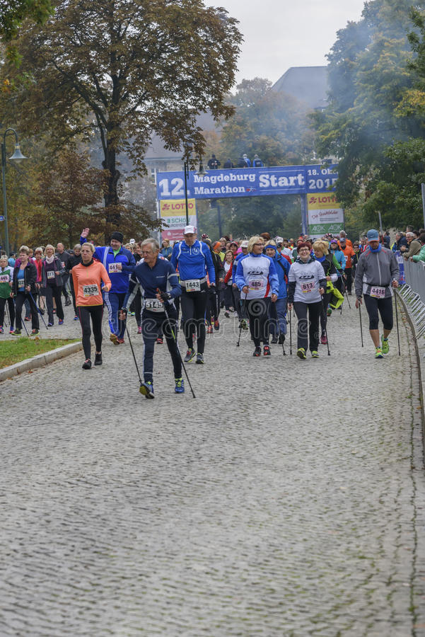 Nordic walking An elderly man pulled ahead Sport holiday, marathon in Germany, Magdeburg, oktober 2015. Nordic walking. An elderly man pulled ahead. Men and stock photo