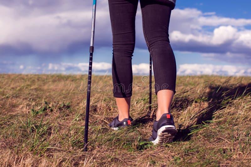 Nordic walking, exercise, adventure, hiking concept -a woman hiking in the nature. Nordic walking, exercise, sport, adventure, hiking concept -a woman hiking in stock image
