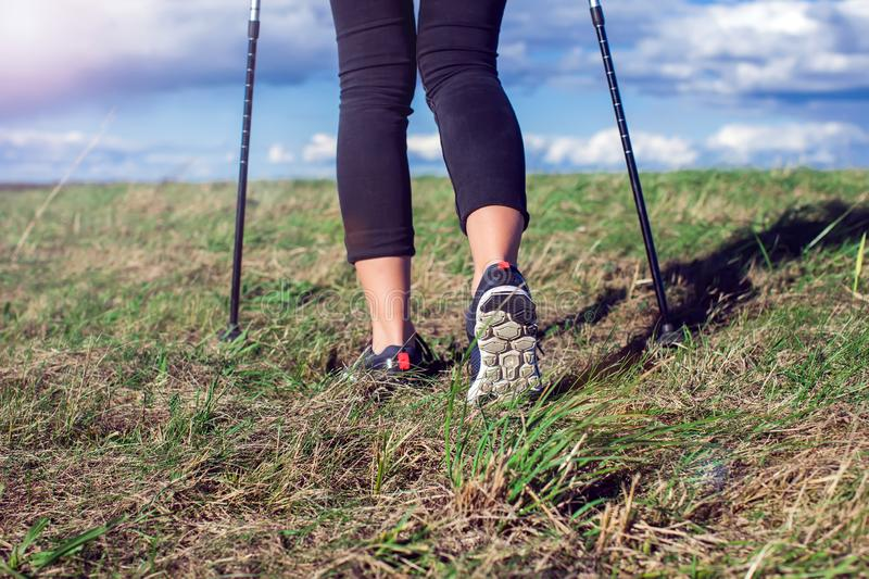 Nordic walking, exercise, adventure, hiking concept -a woman hiking in the nature. Nordic walking, exercise, sport, adventure, hiking concept -a woman hiking in royalty free stock images
